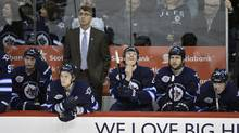 Winnipeg Jets head coach Claude Noel and players watch as the clock winds down in their loss to the Ottawa Senators on Monday. (Fred Greenslade/Reuters/Fred Greenslade/Reuters)