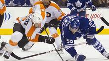 'Get to the 20-games-to-go mark and it's going to be great hockey,' says the Philadelphia Flyers' Mike Knuble, left, battling the Toronto Maple Leafs' Korbinian Holzer this month. (Chris Young/THE CANADIAN PRESS)