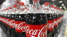 Bottles of Coca-Cola are seen in a warehouse at the Swire Coca-Cola facility in Draper, Utah. (GEORGE FREY/REUTERS)