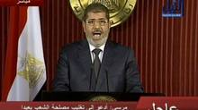 In this image made from video, Egyptian President Mohammed Morsi delivers a televised statement in Cairo, Egypt, Thursday, Dec. 6, 2012. (Nile TV/AP)