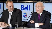 George Cope, left, BCE president and CEO and Ian Greenberg, president and CEO of Astral Media Inc. announce the takeover of Astral by Bell in a deal worth about $3.38-billion on Friday, March 16, 2012 in Montreal. (Paul Chiasson/THE CANADIAN PRESS)