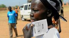 A handout picture from the United Nations Mission in Sudan (UNMIS) shows a southern Sudanese woman holding a ballot paper ahead of the upcoming Southern Sudan independence referendum during a rally in Juba on January 7, 2011. (Tim McKulka/AFP/Getty Images/Tim McKulka/AFP/Getty Images)