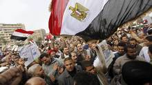 Supporters of Egyptian President Mohamed Mursi and members of the Muslim Brotherhood chant pro-Mursi slogans during a rally in Rabaa El Adaweya Mosque square in Cairo December 14, 2012. (AMR ABDALLAH DALSH/REUTERS)