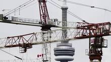 Construction cranes that are being used to build condominium buildings are seen in front of the CN Tower in this file photo. (MARK BLINCH/REUTERS)