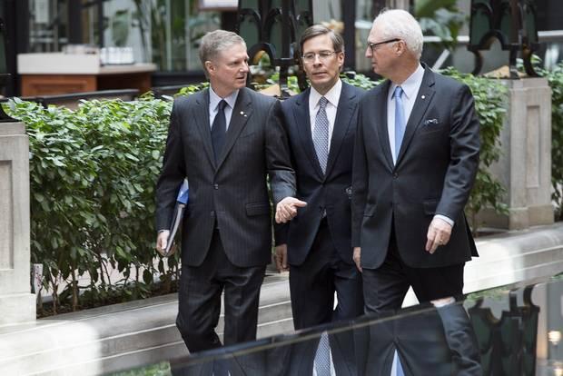 Paul Desmarais Jr., left, Jeffrey Orr, centre, and Andre Desmarais at Power Corp.'s 2014 annual meeting in Montreal.