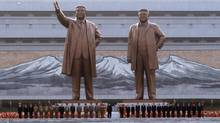 Kim Jong-un, the current leader of North Korea, stands with officials during the unveiling ceremony of bronze statues of North Korea founder Kim Il-sung and late leader Kim Jong-il in Pyongyang. (BOBBY YIP/REUTERS)
