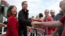 Premier Dalton McGuinty and Prince Edward Hastings MPP Leona Dombrowsky shake hands with supporters outside the Kellogg factory in Belleville, Ontario on September 21, 2011. (Lars Hagberg/THE CANADIAN PRESS)