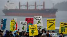 A group of protesters gathers outside the Northern Gateway hearings in Prince Rupert, B.C., on Dec. 10, 2012. (Jonathan Hayward/The Canadian Press)