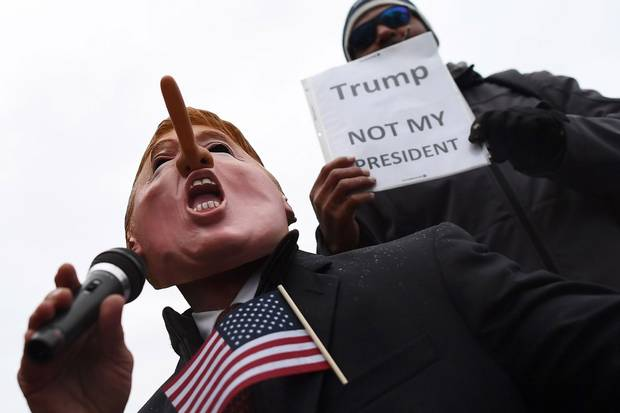 "Jan. 20, 2017: Demonstrators in Washington gather to protest against the inauguration. Mr. Trump's attacks on the media and ""fake news"" have driven, or at least coincidede, with an alarming collapse of trust in the press."