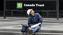 A construction worker sits in front of TD Canada-Trust Head office in Toronto, May 26, 2011. (J.P. Moczulski for The Globe and Mail/J.P. Moczulski for The Globe and Mail)