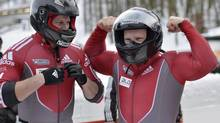 Lyndon Rush, right, and Jesse Lumsden won gold for Canada in Saturday's World Cup bobsleigh race in La Plagne, France. (file photo) (Martin Meissner/AP)