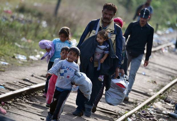 Migrants cross the border between Hungary and Serbia near Roszke village on Sept. 14, 2015.