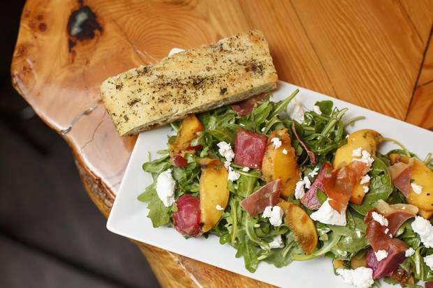 Cilantro and Chive in Lacombe has a knack for salads, including this one, topped with grilled peach and proscuitto.