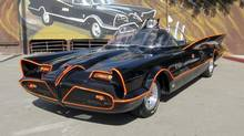 This October 2012 file photo provided by Barrett-Jackson/George Barris shows the original Batmobile in Los Angeles. Batman's original ride, from the 1960s TV series, has sold at auction for $4.2 million on Saturday, Jan. 19, 2013. (Courtesy Barrett-Jackson/George Barris/AP)