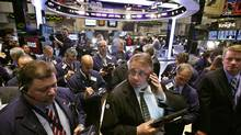 Traders work on the floor of the New York Stock Exchange, October 26, 2012. (BRENDAN MCDERMID/REUTERS)