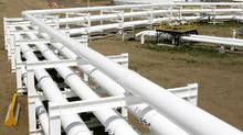 Pipelines feed crude oil into in the tank farm at the Enbridge Pipelines oil terminal facility in Hardisty, Alta. Enbridge, Inc. ownes 72 per cent of Enbridge Income Fund Holdings, Inc. (Larry MacDougal/The Canadian Press/Larry MacDougal/The Canadian Press)