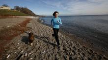 Sal Sloan, owner of Fetching, exercises with her dog Chewy near the waterworks building and the beach in Toronto, where she often holds outdoor exercise classes for people to do with their dogs. (Deborah Baic / The Globe and Mail/Deborah Baic / The Globe and Mail)