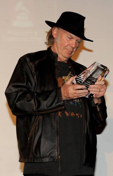 Let's kick off the jamboree with a fine homegrown celebrity. In Los Angeles, the Grammys folks handed out an advance award to Canadian music legend and noted Stephen Harper critic Neil Young, but the type was so small that Neil couldn't read the dang thing (Frank Micelotta/Frank Micelotta/Invision/AP)