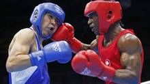 Canada's Custio Clayton (R) fights against Mexico's Oscar Molina Casillas in the men's welter (69kg) Round of 32 boxing match at ExCeL venue during the London 2012 Olympic Games July 29, 2012. (MURAD SEZER/REUTERS)