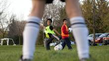 Children take part in a soccer practice on a public field in Toronto. (Chris Young for The Globe and Mail)