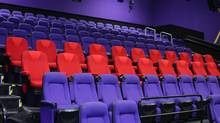 Two rows of D-Box's robotic theatre seats.