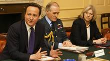 Britain's Prime Minister David Cameron, left, chairs the first meeting of the National Security Council on Wednesday. Others in attendance included Chief of the Defence Staff Sir Jock Stirrup and Home Secretary Theresa May. (POOL/REUTERS/)