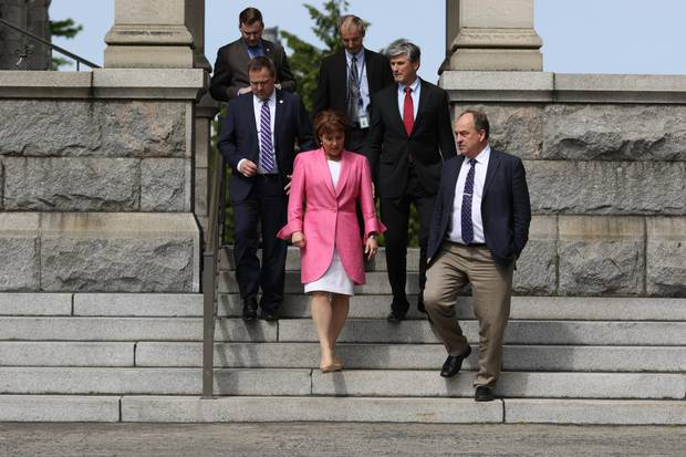 Premier Christy Clark and Green Party Leader Andrew Weaver, leave the legislature to speak to media during an April 2016 press conference. The pair developed a working relationship in the legislature, for instance when Ms. Clark adopted Mr. Weaver's proposal to require universities to create sexual assault policies.