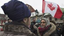People wear religious headwear during a gathering in Montreal on Jan. 12, 2014, to oppose the proposed Charter of Quebec Values. (GRAHAM HUGHES/THE CANADIAN PRESS)