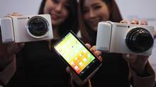 Models pose with sets of Samsung Electronics' Galaxy Camera during its launch event at the company's headquarters in Seoul November 29, 2012. (KIM HONG-JI/REUTERS)