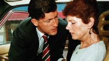 43-year-old Sue Rodriguez is consoled by NDP MP Svend Robinson after leaving a press conference in Victoria Sept. 30, 1993. (Jeff Vinnick/REUTERS)