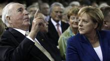 Former German Chancellor Helmut Kohl and German Chancellor Angela Merkel (R) during ceremony of the Christian Democratic Union (CDU) party to mark the upcoming 20-year anniversary of the German unification in Berlin. (FABRIZIO BENSCH/REUTERS)