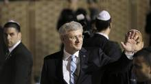 Prime Minister Stephen Harper waves during his visit to the Western Wall in Jerusalem's Old City on January 21, 2014. (AMMAR AWAD/REUTERS)