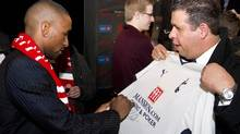 Toronto FC new soccer player Jermain Defoe signs shirt for fan Glenn Zumrawi after a news conference announcing his incorporation to the club, Toronto, January 13, 2014. (Fernando Morales/The Globe and Mail)