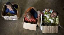 War-orphaned children sit in cardboard boxes at the Kizito orphanage in Bunia in northeastern Congo February 24, 2009. (Finbarr O'Reilly / Reuters/Finbarr O'Reilly / Reuters)