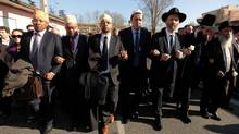 Jewish and Muslim leaders link arms in a silent march to honour the victims of a shooting at the Ozar Hatorah school, where a rabbi and three children were killed in Toulouse March 25, 2012. (Zohra Bensemra/Reuters/Zohra Bensemra/Reuters)