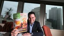 Philippe Cloutier, general manager of Reader's Digest Association (Canada), shows off a mock-up of the company's newest title, Taste of Home Canada. (Christinne Muschi for The Globe and Mail)