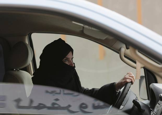 In this Saturday, March 29, 2014 file photo, Aziza Yousef drives a car on a highway in Riyadh, Saudi Arabia, as part of a campaign to defy Saudi Arabia's ban on women driving.