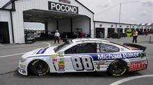 Dale Earnhardt Jr. (88) drives in the garages during practice for Sunday's NASCAR Sprint Cup Series auto race at Pocono Raceway, Friday, Aug. 1, 2014, Long Pond, Pa. (Mel Evans/AP)