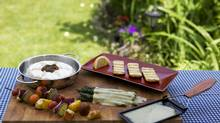 Clockwise from top left, the Brie Baker, Guernsey Girl grilled cheese portions, Barbeclette cheese melter, Appenzeller cheese melted over asparagus, Guernsey Girl and vegetable kabobs. (Michelle Siu/The Globe and Mail)