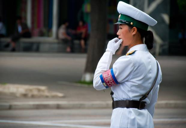 A traffic official directs vehicles in North Korea.
