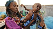 A woman shows her malnourished baby at an intensive nutritional rehabilitation centre (CRENI) in Tanout, southern Niger, on April 27, 2010. (Sia Kambou/AFP/Getty Images)