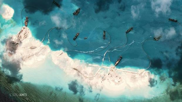 Chinese dredging vessels built up the land on Mischief Reef in the South China Sea.