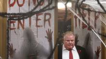 Toronto Mayor Rob Ford walks out of his office past Halloween decorations to meet briefly with reporters on Oct. 31, 2013. (MOE DOIRON/THE GLOBE AND MAIL)