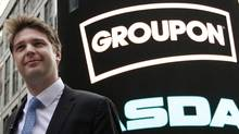 What a difference a year makes: Groupon CEO Andrew Mason outside the Nasdaq Market following his company's IPO in New York in this file photo taken November 4, 2011. Reports now suggest his board is looking to turf the youthful CEO. (BRENDAN MCDERMID/REUTERS)