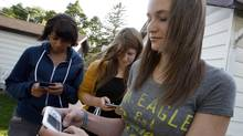 Celine Huberdeau, right, with friends Cassidy Peleuses and Danelle Nyzai, left, who text message each other alot. (BORIS MINKEVICH/The Canadian Press)