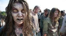 In this image released by AMC, zombies appear in a scene from the second season of The Walking Dead. (Gene Page/AP)