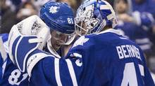 Toronto Maple Leafs goaltender Jonathan Bernier (right) and two goal scorer Phil Kessel celebrate after their 5-2 win over Carolina Hurricanes in NHL hockey action in Toronto on Sunday December 29, 2013. (CHRIS YOUNG/THE CANADIAN PRESS)