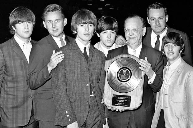 The Beatles pose with executives from Capitol Records backstage at Maple Leaf Gardens in Toronto in September, 1964. From left: John Lennon, Paul White, George Harrison, Paul McCartney, Geoffrey Racine (holding an award), Taylor Campbell and Ringo Starr. Mr. White designed and compiled several Canadian-only albums by the Fab Four.