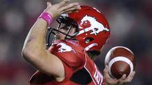 Calgary Stampeders quarterback Drew Tate passes the ball during the first half of their CFL football game against the Saskatchewan Roughriders in Calgary, Alberta, October 21, 2011. REUTERS/Todd Korol (Todd Korol/Reuters)