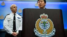 Vancouver Police Chief Jim Chu, right, responds to commissioner Wally Oppal's inquiry report into the missing women of the Downtown Eastside as Deputy Chief Doug LePard listens during a news conference in Vancouver on Dec 18, 2012. (Darryl Dyck/The Canadian Press)